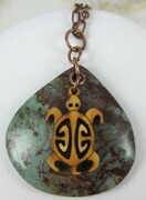 African green opal pendant with wood turtle charm and copper charm
