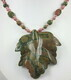 Carved rhyolite leaf with unakite and rhodonite