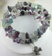 Green, blue, clear, and purple fluorite memory wire bracelet with pewter peace dove charm
