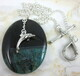 Green onyx agate druzy geode pendant with pewter dolphin