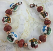 Llama bead bracelet with sponge coral and copper spacers