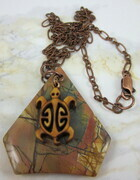Picasso jasper gemstone pendant with a carved wood turtle (honu)